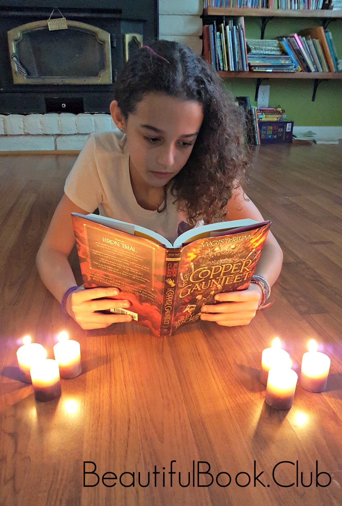 Me with The Copper Gauntlet Book with candles