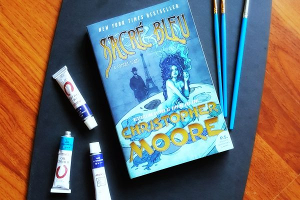 Sacré Bleu by Christopher Moore book cover with paint set beautiful book club