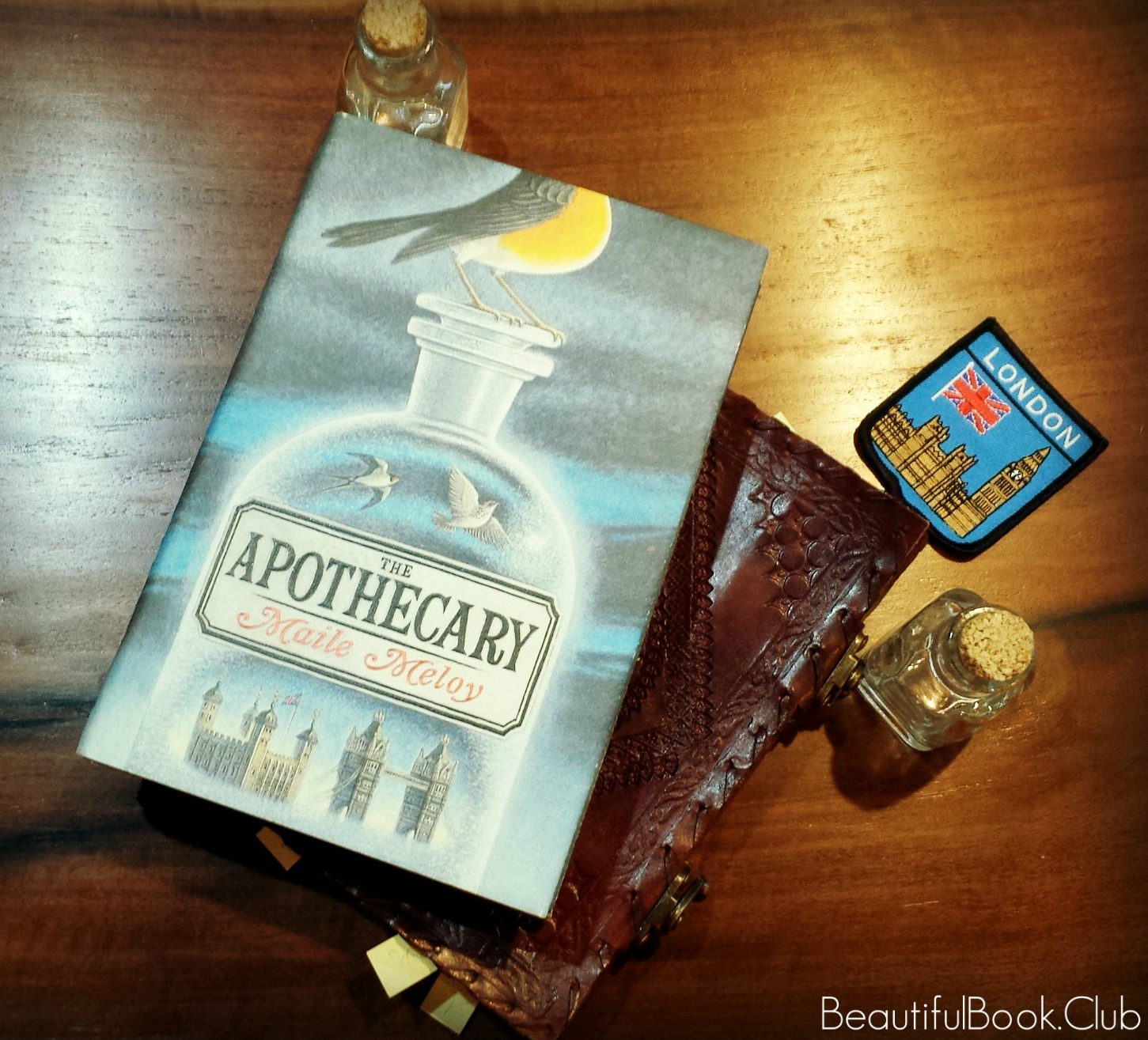 The Apothecary front cover with little trinkets