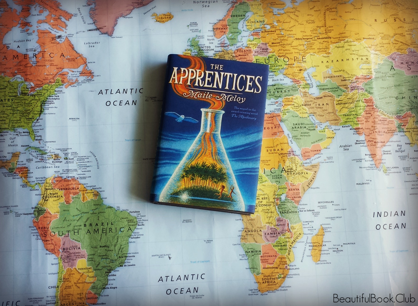 The Apprentices by maile meloy front cover on a map