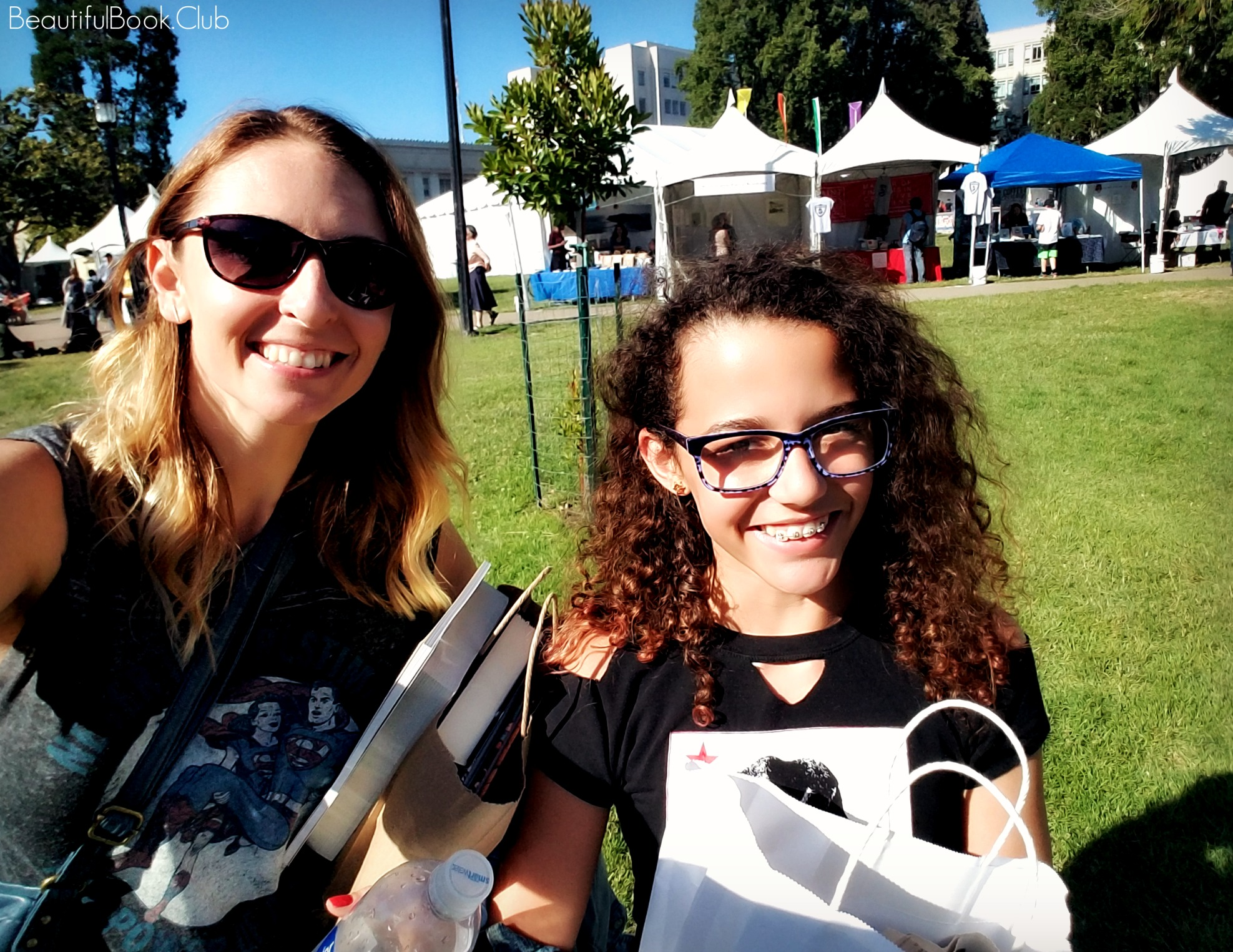 Bay Area Book Festival selfie with book booths and tons of books