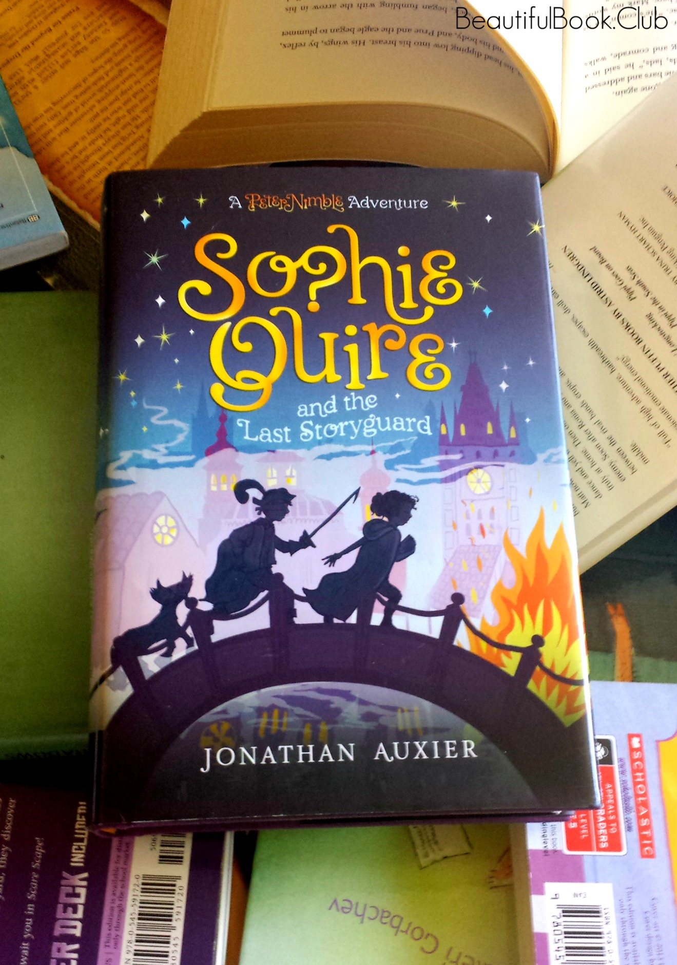 Sophie Quire and the Last storyguard by Jonathan Auxier front cover with book jacket
