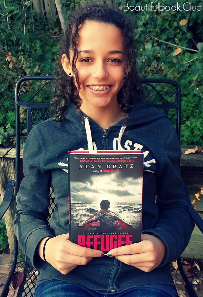 Me with the book, Refugee by Alan Gratz